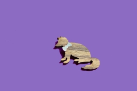 wooden fox brooch with silver bowtie